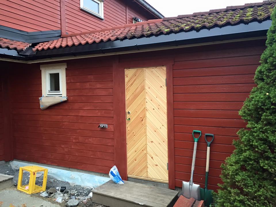 tilbygg på rødt hus